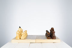 Black and white chess pieces on a chessboard Royalty Free Stock Images