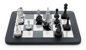 Black and white chess pieces standing on tablet computer. 3D illustration.  Royalty Free Stock Image