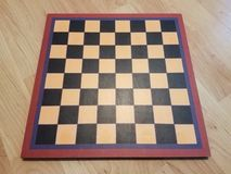 Black and white chessboard or checkerboard on wood floor. A black and white chessboard or checkerboard on wood floor royalty free stock photography