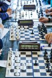 Black and white chessboard in the classroom on the table. Lesson, training, intellectual game royalty free stock images