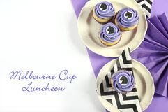 Black and white chevron with purple theme party luncheon cupcakes with sample text. Stock Images