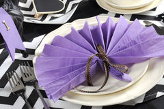 Black and white chevron with purple theme party luncheon table closeup. Black and white chevron with purple theme party luncheon table place setting for Stock Photography