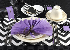 Black and white chevron with purple theme party luncheon table. Place setting for Melbourne Cup, Australian public holiday, horse race event Royalty Free Stock Photo