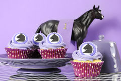 Black and white chevron with purple theme racing party cupcakes. Black and white chevron with purple theme party luncheon table place setting for Melbourne Cup Stock Images