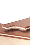 Black and white chocolate on the wooden board Royalty Free Stock Photography