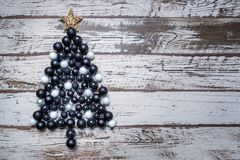 Black and White Christmas Balls as Christmas Tree on Shabby Wood Planks.  Royalty Free Stock Photo