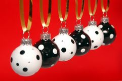 Black and white christmas ornament. Line of black and white christmas balls on red backgroung stock images