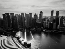 Black and White Cityscape of Marina Bay in Singapore. The cityscape of Singapore at sunset, with the sun casting hard shadows of the skyscrapers across Marina Royalty Free Stock Image