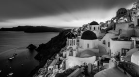 Traditional greek village of Oia in black and white, Santorini island, Greece. Black and white cityscape of Oia, traditional greek village with blue domes of stock images