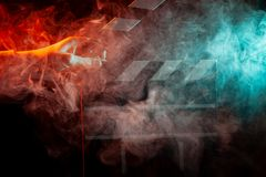Black and white clapperboard for cinema close up among multicolored red and green smoke in a man's hand giving a command to sta royalty free stock photos