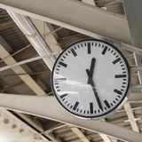 Black and white clock. Public clock at railway station Stock Images