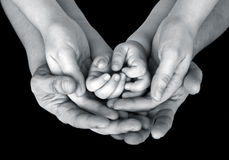 Black and white close up image of a family's supporting hands Royalty Free Stock Images