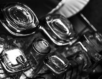 Black and white close-up image of whiskey Old Fashioned or Rocks glasses along with shot or shooter glasses on a dish drainer in t. He kitchen Stock Photography