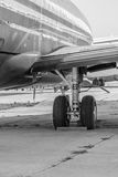 Black and white close-up of an open landing gear. Detailed black Stock Images