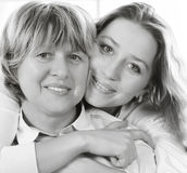Black and white close up portrait of a mature mother and adult d Royalty Free Stock Photography