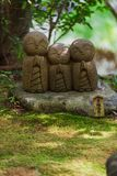 Close-up row of stone Jizo Bodhisattva statues in Kamakura, Japan. Royalty Free Stock Photo