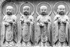 Black and White, Close-up row of stone Jizo Bodhisattva statues in the Hase-dera temple stock photo