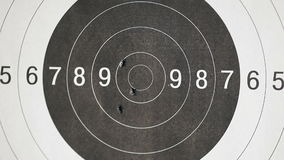 Black and white, Close up of a shooting target and bullseye with bullet holes stock video footage