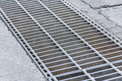 Black and white close up of a sidewalk subway grate with shallow Royalty Free Stock Photo