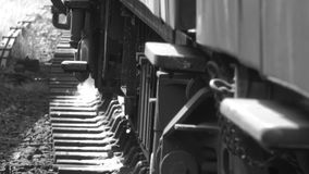 Black and white close up of steam train on track 4K. Close up of wheels moving of steam train on track 4K stock footage