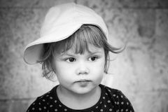Black and white closeup portrait of baby girl cap Stock Images