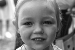 Black and white closeup portrait of a cute little girl stock photo
