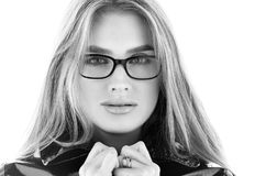 Black and white closeup portrait of stylish young woman in glasses Stock Photos