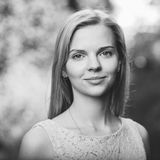 Black and white closeup portrait of a young beautiful blonde woman with a forest background Royalty Free Stock Photo