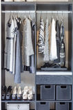 Black and white clothes in black closet Royalty Free Stock Image