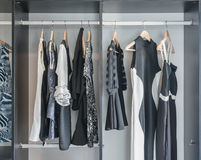 Black and white clothes hanging in closet Stock Photography