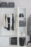 Black and white clothes hanging in wardrobe royalty free stock images