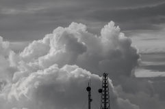 Black and white clouds and sky with top of antenna. The black and white clouds and sky with top of antenna Stock Photo