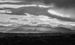 Black and white cloudy and misty sunset stock images