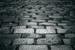 Black and white cobblestones background Stock Photos