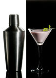 Black and white cocktail. Metal cocktail shaker and cream cocktail with mint leaves on a black and white  background Royalty Free Stock Photo