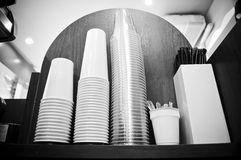 Black and White Coffee Cups. In cafe Stock Image