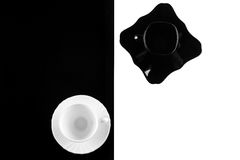 Black and white coffee cups with plates Stock Image