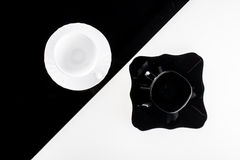 Black and white coffee cups with plates Royalty Free Stock Photography