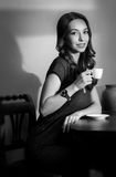 Black and white coffee girl. Royalty Free Stock Photo