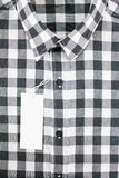Shirt. Black and white color for men in checked pattern royalty free stock images