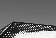 Black and white color roof in snow. Stock Photos