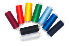 Black and white and colored thread spools Stock Photo