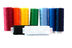 Black and white and colored thread spools Stock Images