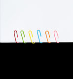 Black and white  Colorful paperclips Stock Image