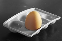 Black and white and coloured. Just the egg coloured in black and white in egg-cup Stock Photo