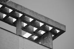 A concrete lattice visor of old building. Black and white composition of concrete lattice visor of old building Royalty Free Stock Photos