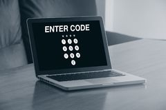 Black and white of computer with an ENTER CODE access page in th Stock Photo