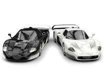 Black and white concept race cars with inverted color details Stock Images