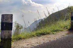 Black and white concrete pillar in lush green ponmudi hill Stock Image