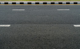 Black and white concrete road curb Stock Image